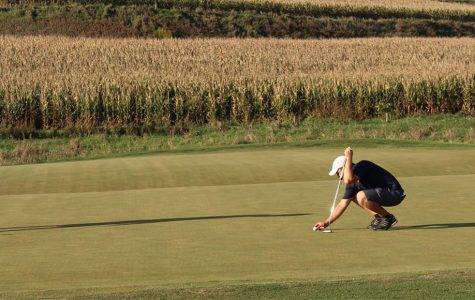 John Bral competes in final IIAC championships