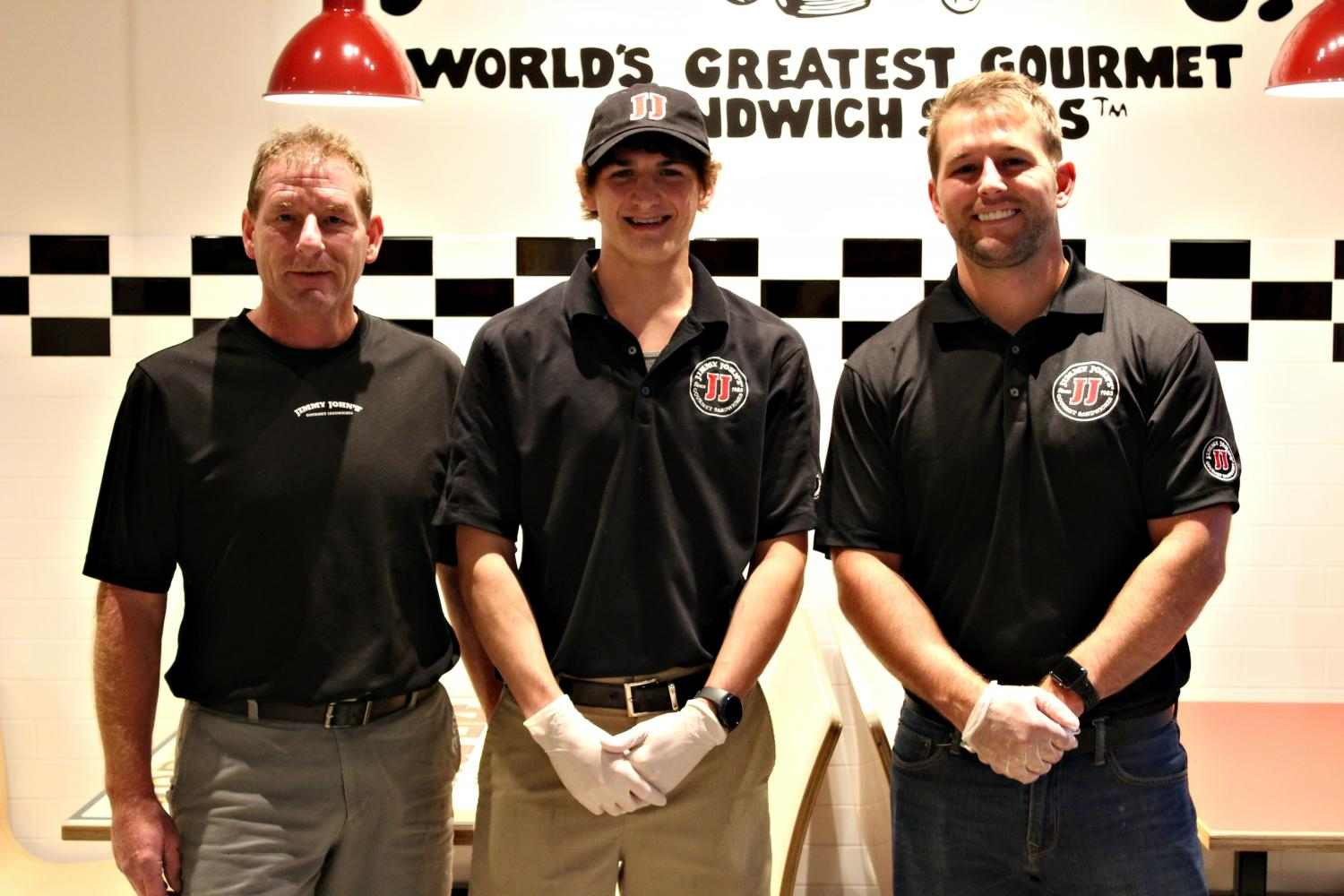 Rick Hartwig, General Manager; Alex Wright, Certified Manager; and Houston Hartwig, Owner