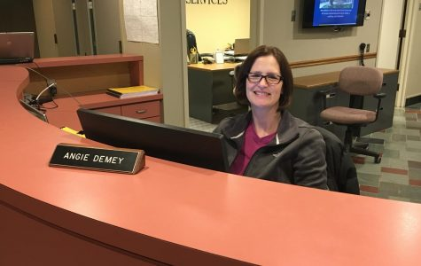 At Info Desk, DeMey is heart of campus
