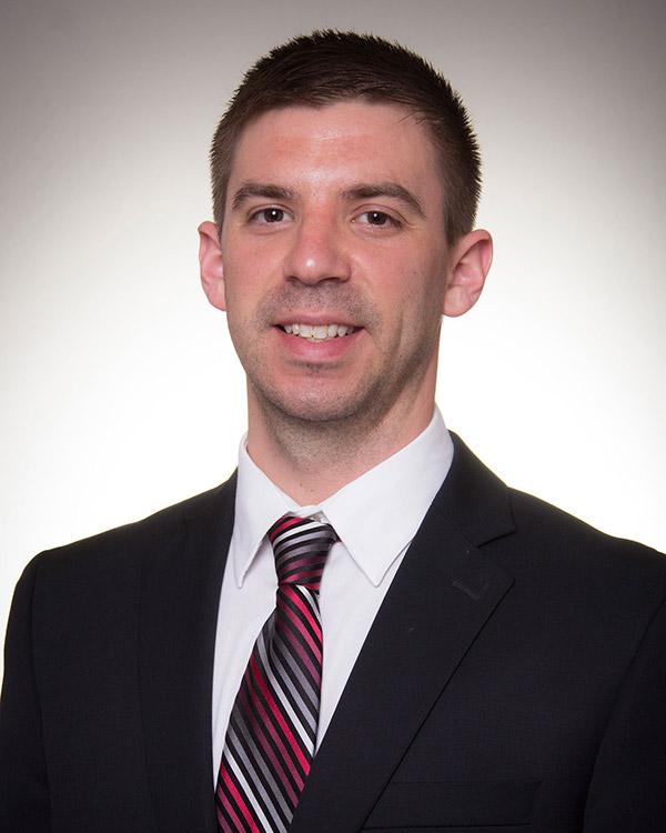 Lorensen name new head men's basketball coach