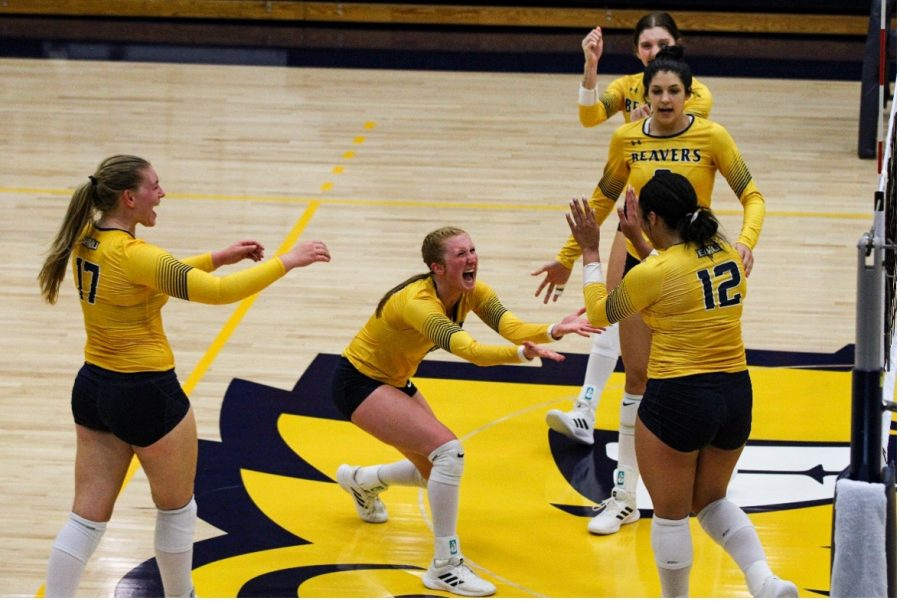 Buena Vista University Volleyball team celebrates after a score against Bethany Lutheran College.