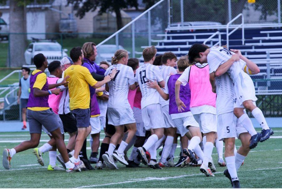 Buena Vista University Men's Soccer team celebrates after defeating Dordt University in overtime.