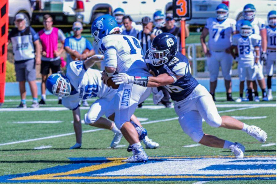 Buena Vista University Linebacker TANNER FROST sacks the quarterback against Luther College.